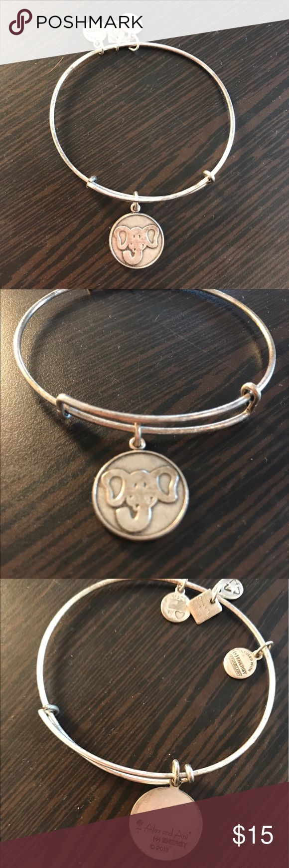 Alex & Ani silver elephant bangle Alex & Ani silver bangle with an elephant charm. It's a little tarnished as you can see in the pictures. Adjustable sizing and a cute little bangle! Alex & Ani Jewelry Bracelets