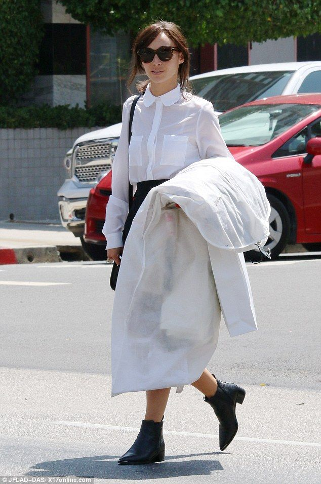 Errand girl: The 31-year-old was spotted picking up some dry cleaning while wearing a tiny...