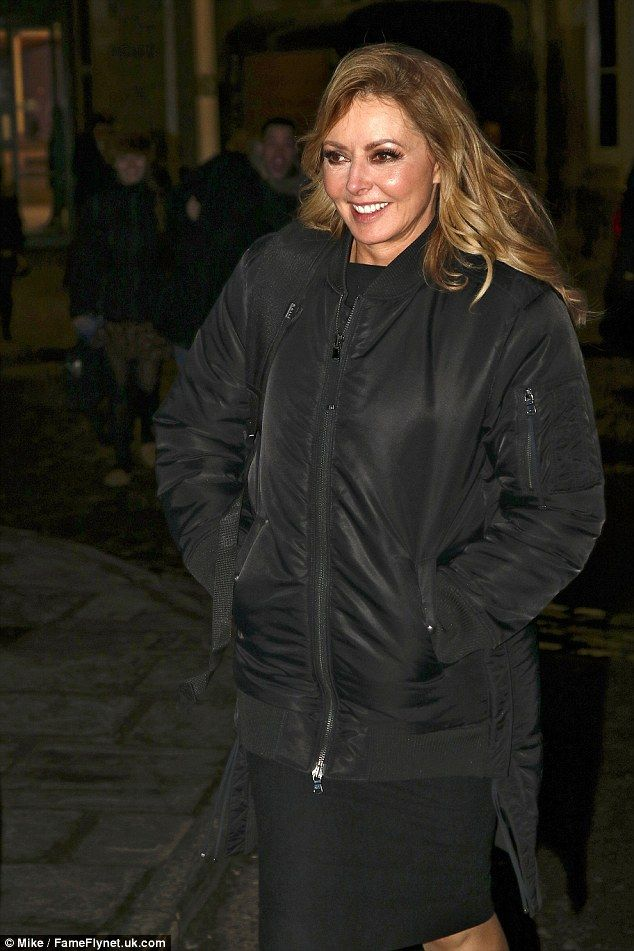 Woman in Black! Carol Vorderman, 56, kept her incredibly curvaceous figure well under wraps as she left the Temple Meads train station in Bristol on Monday evening