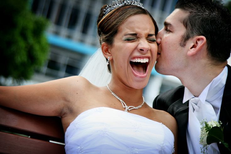Groom tickling Bride's ear - a wedding from a few years a go, but still one that makes us smile!