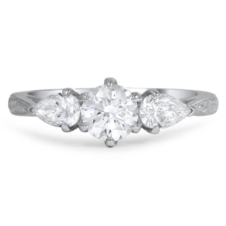 This Stunning Three Stone Engagement Ring Features A Round