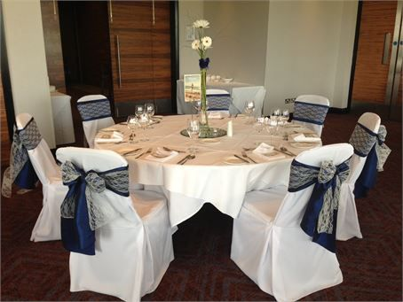 We provided luxury linen chair covers (with double sash) and beautifully simple stem vase and blooms for a wedding breakfast.
