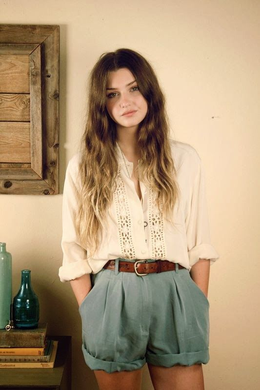 Baggy cream blouse with baggy tailored shorts and brown belt