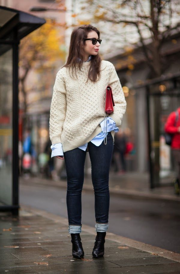 Oversized neutral sweater, chambray button-down, dark-wash skinny jeans