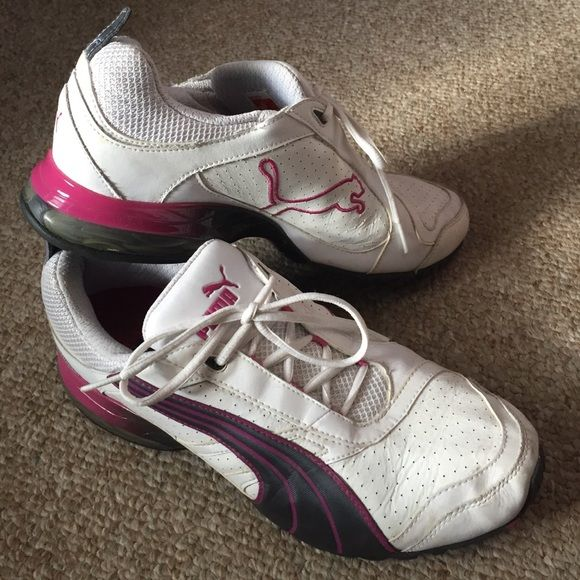 Women's Size 11 Puma Tennis Shoes Women's size 11 Puma Tennis Shoes. White, purple, and pink. Very minimally worn. Smoke free home. Puma Shoes Athletic Shoes