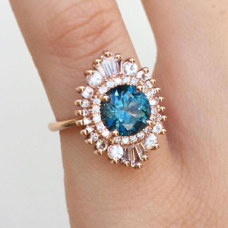 This sapphire is so cool!!! (ovals and pear shapes would be even cooler!) Vivid teal sapphire in a one carat size Cambria Waterfall ring. <3 Heidi Gibson