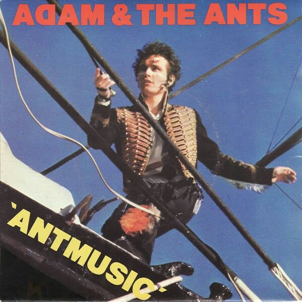 Adam and the Ants Antmusic   Release date 28th November 1980  A-side Antmusic  B-side Fall in  The third single to be taken from the Kings of the Wild Frontier album.  The front and back cover of the single were taken on board a ship moored on the Thames. These are also the first photographs taken of the whole of the band.  The B-side, Fall in, is an old Ants song from 1977 co written with Lester Square.  For the initial release the ADAM AND THE ANTS font on the label is in large bold font…