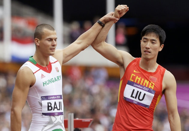 The Olympics record holder in the men's 110-meter hurdles injured himself while warming up for his first race at the Beijing Games, where he was expected to defend his Olympic title from Athens. On Tuesday, the Chinese star hit the first hurdle, crashed to the ground and laid there while Great Britain's Andrew Turner won the last of six heats.   http://sports.yahoo.com/news/olympics--liu-xiang-injured-again-in-olympic-qualifying.html