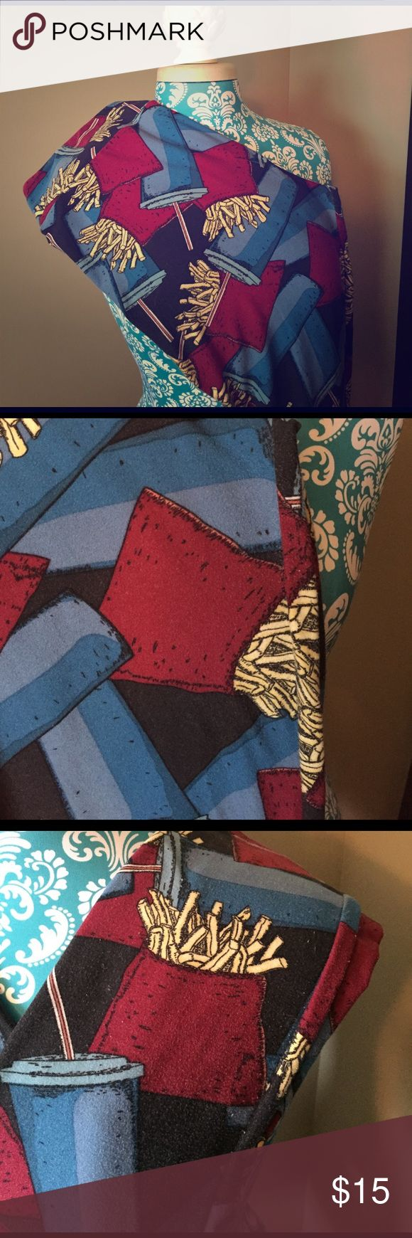 """LuLaRoe TC Fry & Drink Leggings 🍟 LuLaRoe TC Fry & Drink Leggings. I can no longer wear TC leggings. Thick, soft & buttery! Black background with blue & teal cups and maroon/yellow French fries. So FUN!!! I wore these out of the house once to the movies & mostly as pjs. They have been worn a handful of times and I have noticed several dark pair of LLR seem to fade instantly. There are signs of wear, some piling & fading as seen in the pics. I have not tried to """"shave"""" any of it. They have…"""