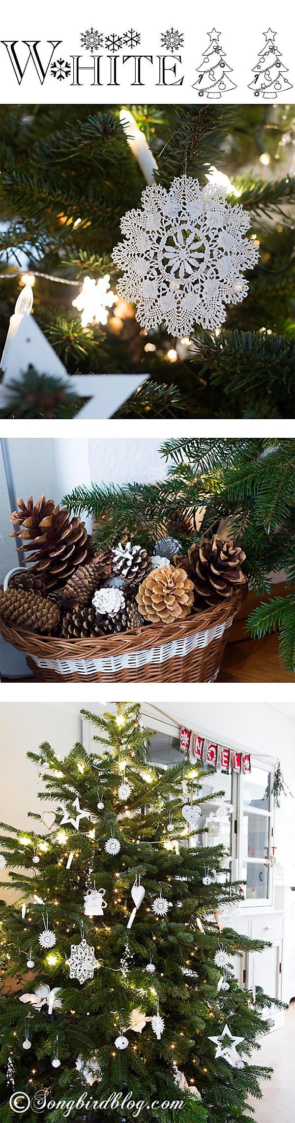 Nordic, Scandinavian Christmas tree with all white ornaments, like handmade crochet snowflakes and wooden stars. Via http://www.songbirdblog.com