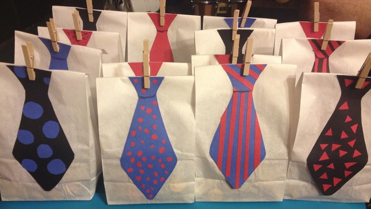 I hand cut out ties and used a white lunch bags to make lil man goodie bags!!