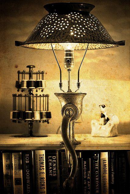 Collander Lamp.  Make from old collander.  Use a teapot or old vase for base.