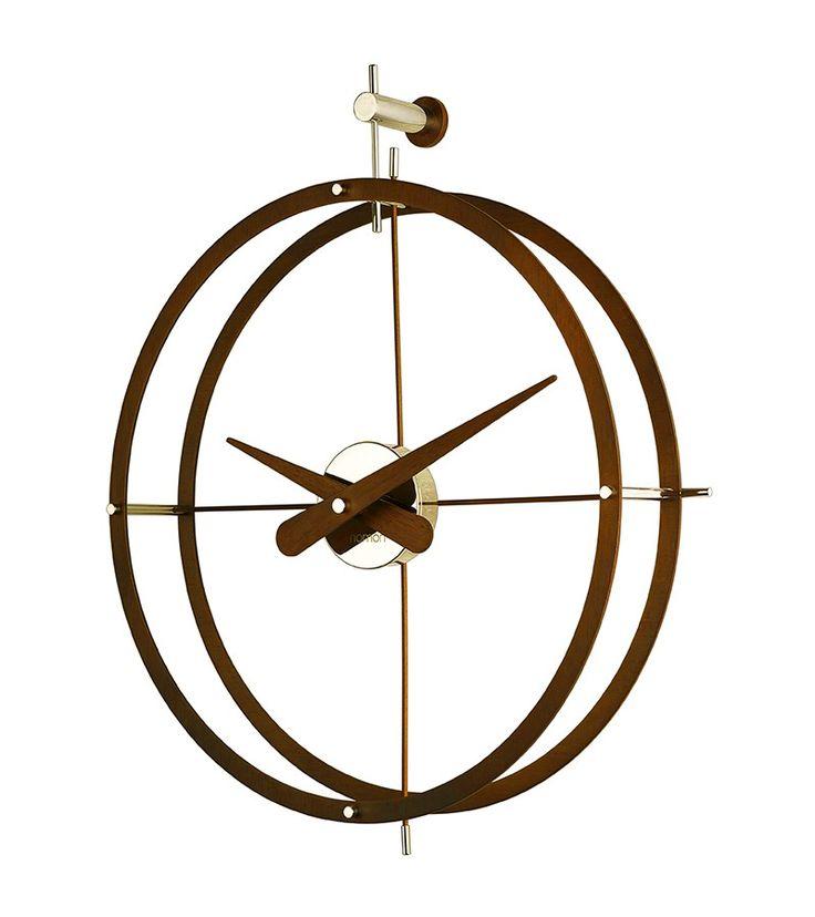 Elegante reloj de diseño colgado para pared 2 puntos · Elegant Design Wall Clock 2 Puntos 80x70 Acero con acabado cromado en la caja y pulido en los aros y agujas. En color gris metálico o lacado en oscuro. www.armonyspace.com
