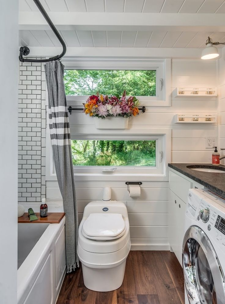love this bathroom/laundry combo - and the hanging flowers