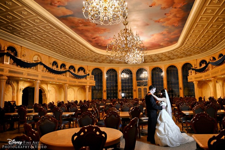 "A bride and groom at the new Be Our Guest Restaurant in WDW Florida. This is absolutely beautiful! Can't you just hear Angela Lansbury singing ""Beauty and the Beast?"""