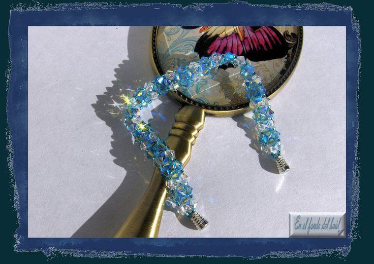 Pulsera Cielo - Dos tonos de tupis de cristal Swarovski con delicas Miyuki con baño de plata y cierre imantado.
