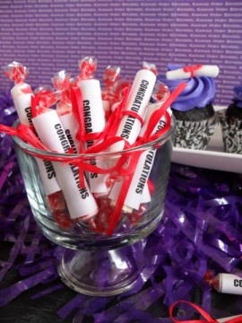 """Graduation - A dish full of Smarties candies with a label  created saying """"Congratulations!"""" These make a cute candy favor for the guests."""