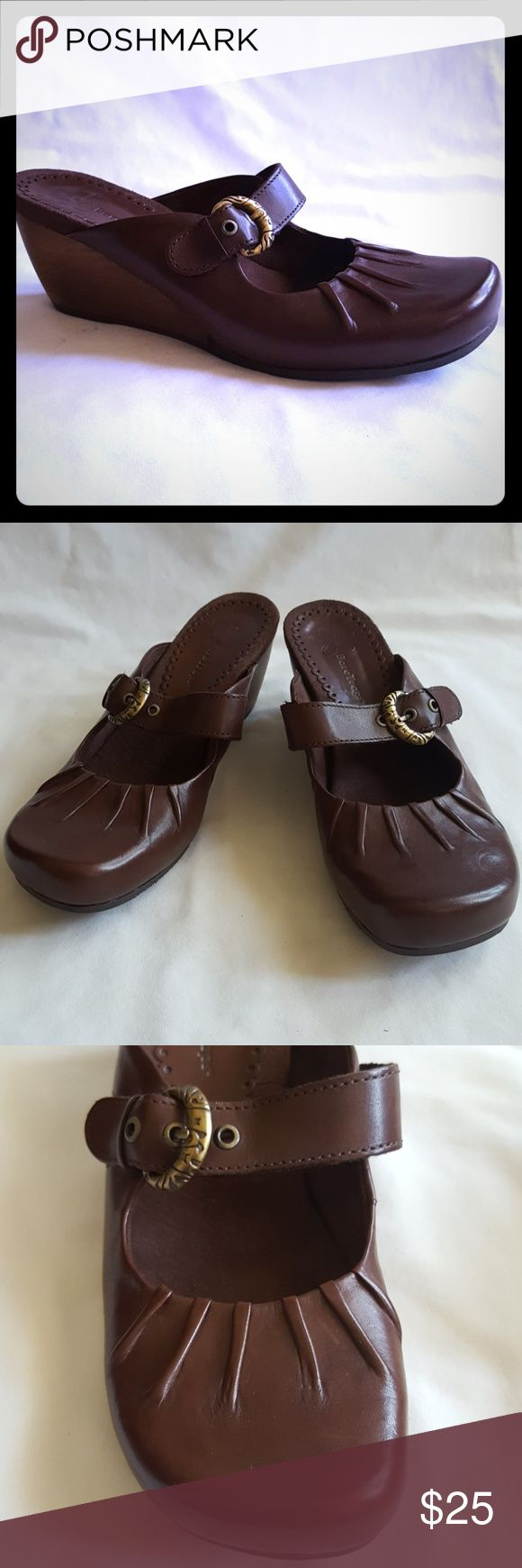 """NWOT Bare Traps Brown Leather Wooden Heel Wedge Cute brown leather Mary Jane mules style rounded toe wedges with unique wooden 2 3/4"""" wedge heel. Cushion brown suede-like insole. Style is """"Gayle"""" size 8 1/2.   New - without tags and box. Smoke free and pet free home. Bare Traps Shoes Wedges"""