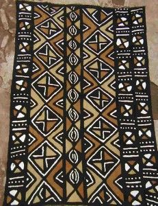 African Fabric, would use a similar pattern and colors for cover chair cushions and curtains