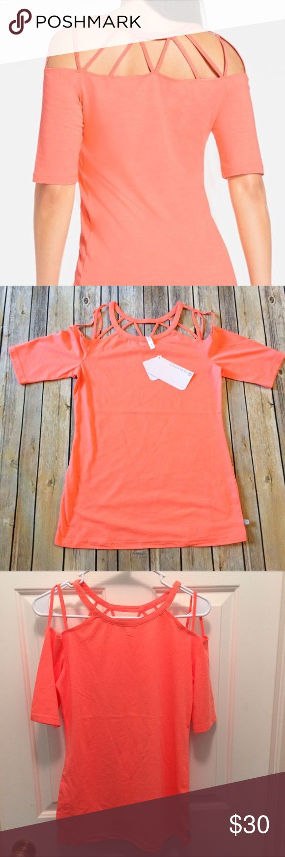 🔶Fabletics top Brand New! Bright coral orange  strappy top.           🔴Red dot items the price is firm 🔵 Blue dot items offers welcome 🔶 Yellow diamond discounted in bundles only.                                         Please make a bundle and request a private offer Fabletics Tops