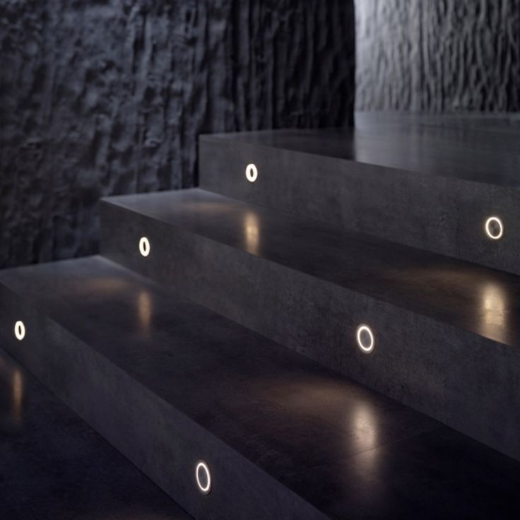 G-O Wall Light by Flos Architectural makes walking up these steps easy during t he night.