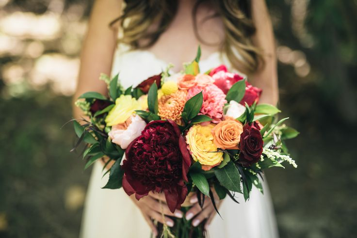 BOHEMIAN BREWERY WEDDING | Stunning, bold colored bridal bouquet. This beauty is perfect for the nontraditional or bohemian bride. We love the deep reds, oranges and yellow and greenery!