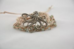 """Bungalow"" Bracelet, 6-strand, waxed cotton cord, double square knotted with large metal octopus element. Handcrafted, natural jewelry made with love in Sarasota, FL."