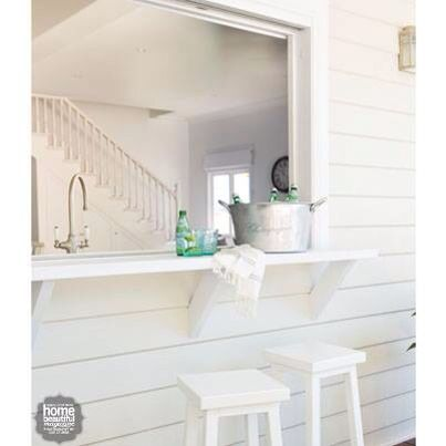 Bi fold window from kitchen to deck. Home Beautiful Magazine.