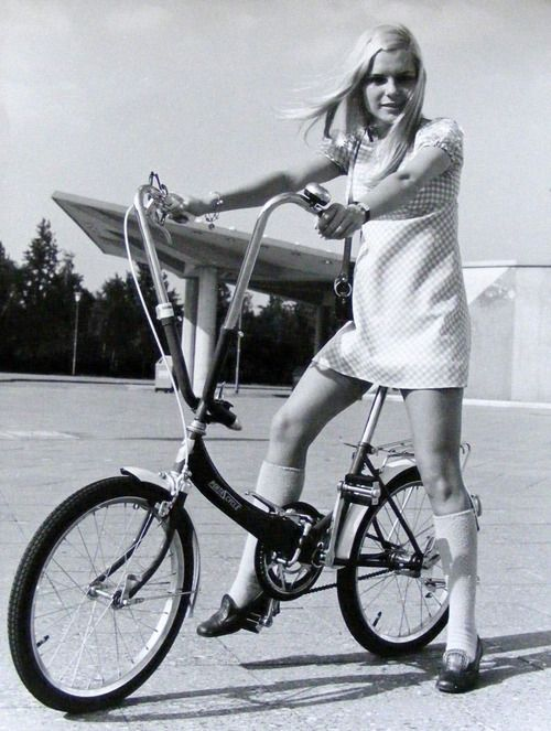 France Gall on a bike, 1960s: Check out the roof line on that building.