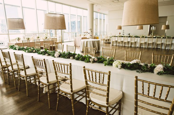 Hanging centerpieces, Wedding flowers, Hanging lampshade centerpieces, Wedding flowers, Greenery and flower garland, Wedding cake, Wedding reception floor plan, Museum wedding inspiration, Mint Museum Uptown wedding in Charlotte, North Carolina by The Graceful Host, blush ivory and greenery wedding