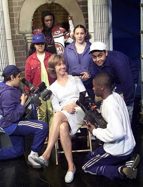 Portrait Sabrina Guinness with some of the students at her Youth Cable Television charity 13th June 2000