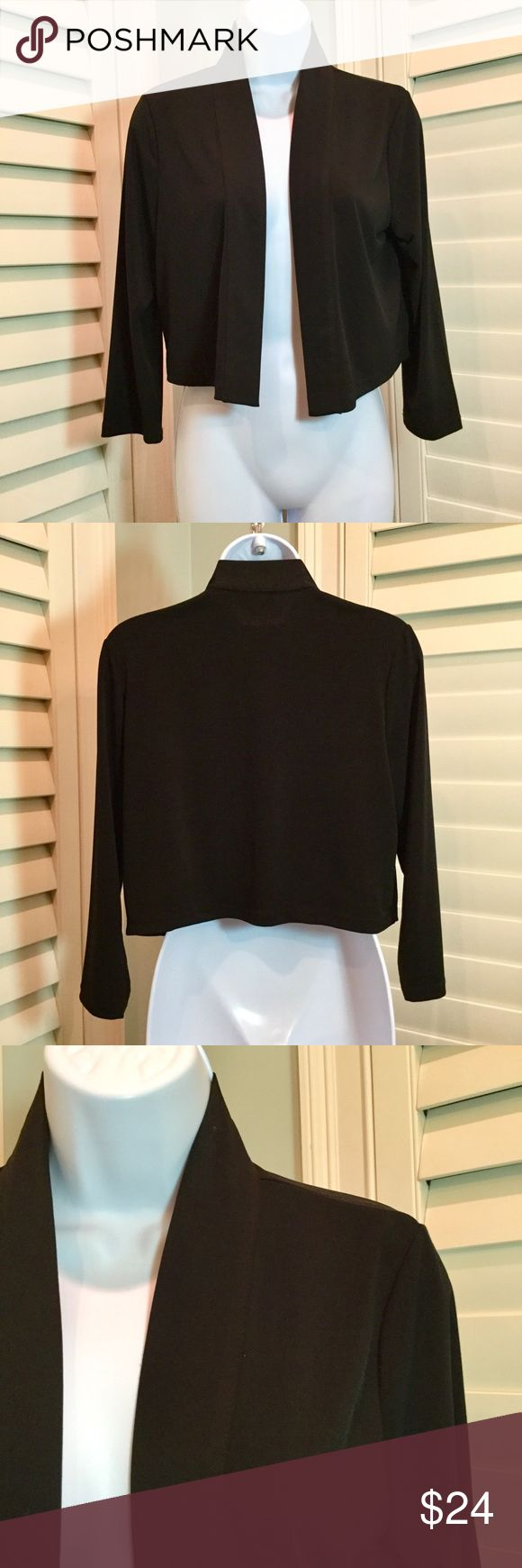 "Calvin Klein Shrug, Medium, EUC Black shrug with 3/4 sleeves. Lightweight and perfect for layering.   🔹95% polyester, 5% spandex  🔹Measurements: back armpit to armpit 18"", length 18"" 🔹Excellent preowned condition with no stains or holes  🔹Smoke free home (Sandy) Calvin Klein Sweaters Shrugs & Ponchos"