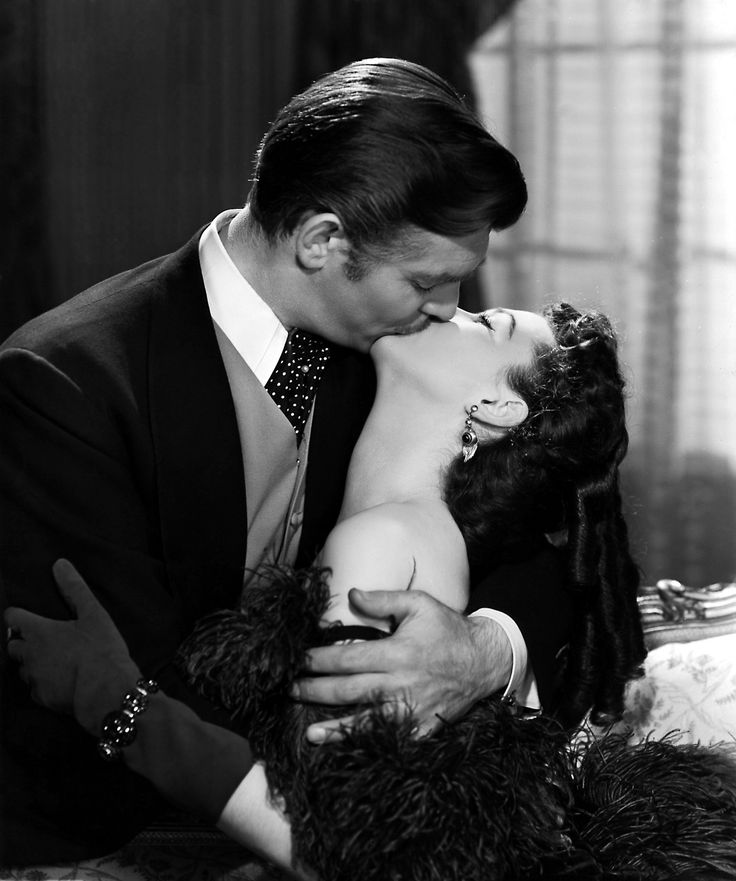"Famous Kiss: Rhett & Scarlett kiss in ""Gone with the Wind""."
