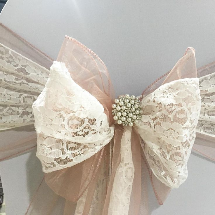 Dusky pink organza sash doubled up with white lace finished with a pearl and…