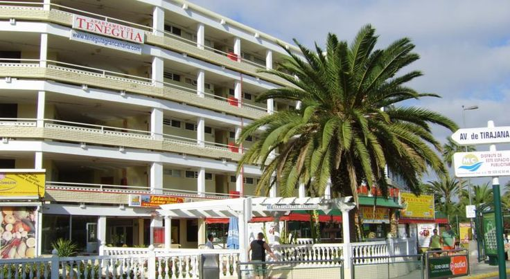 Apartamentos Teneguia Playa del Ingles These apartments are a set near the beach in Playa del Inglés, just 200 metres from the Maspalomas Golf Course. The Teneguía has an outdoor swimming pool and tennis court.  All of the Apartamentos Teneguía come with a private balcony or terrace.