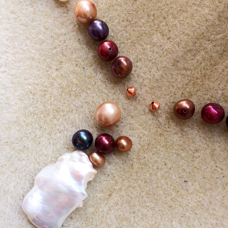 Fresh water pearl pendant with some dyed pearls #design #unique #create #make #GGJewellery
