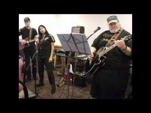 Ditto Plays Santana Song (HD) -- This is my brother Michael (aka Dukeman) and his band, Ditto. I could listen to him sing and play this song all day long.