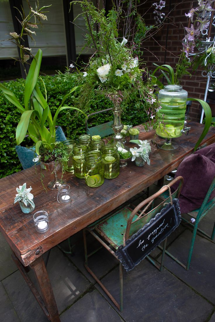 Ideas for small engagement party in the garden from the Chicago  Dearborn Garden Walk #hanging flowers, #rustic #greenglass http://www.dearborngardenwalk.com