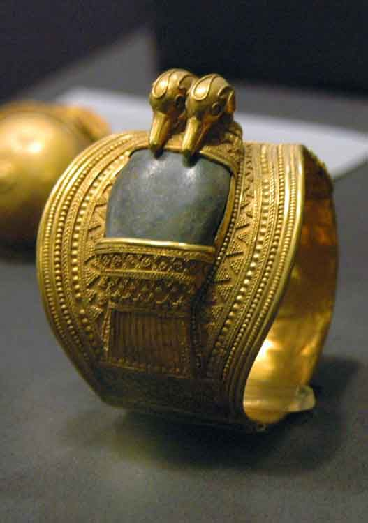 One of a pair of Gold armlets, in gold with inlays, inscribed to King Ramesses II (Usermaatra Setepenra c.1279-1213 BC, Dynasty 19). Cairo Museum, Egypt.