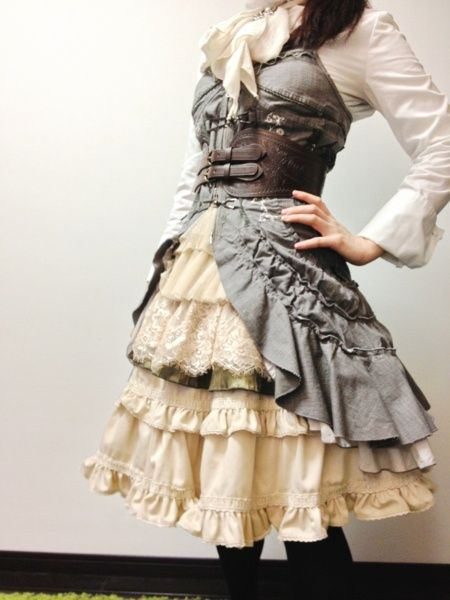"This is ""steampunk"" but The pettycoat with recycled jean vest and bustle is fun.  would look good with any tiered skirt and tunic."