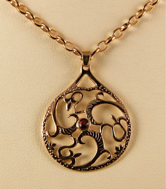 Three Fronds in Rose Gold with Ruby. Graceful and Flowing.