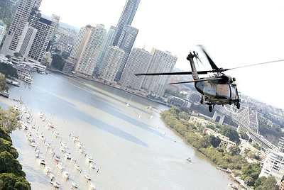 A Blackhawk helicopter from the School of Army Aviation, Oakey, practices it's aerial display routine over the Brisbane river, in preparation for the 2011 Brisbane Riverfire event. Riggs Trophy entrant 2011