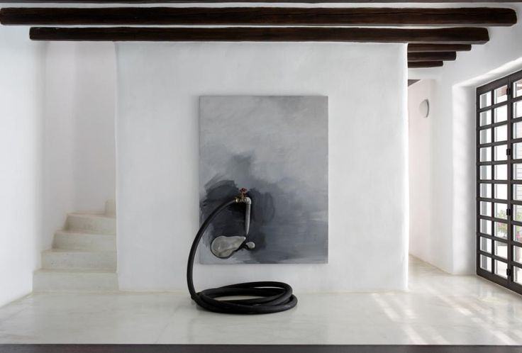 Kostas Tsoklis in white cycladic house