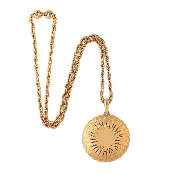 Gorgeous shape and texture. Gold plated starburst pendant. Features unique spherical pendant with textured detail. Long snake chain with fold-over clasp closure