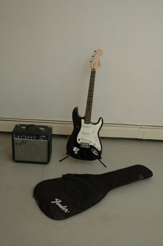 Fender Squire Strat Electric guitar and amplifier lot. Serial number photographed on neck. Small Fender amplifier included.