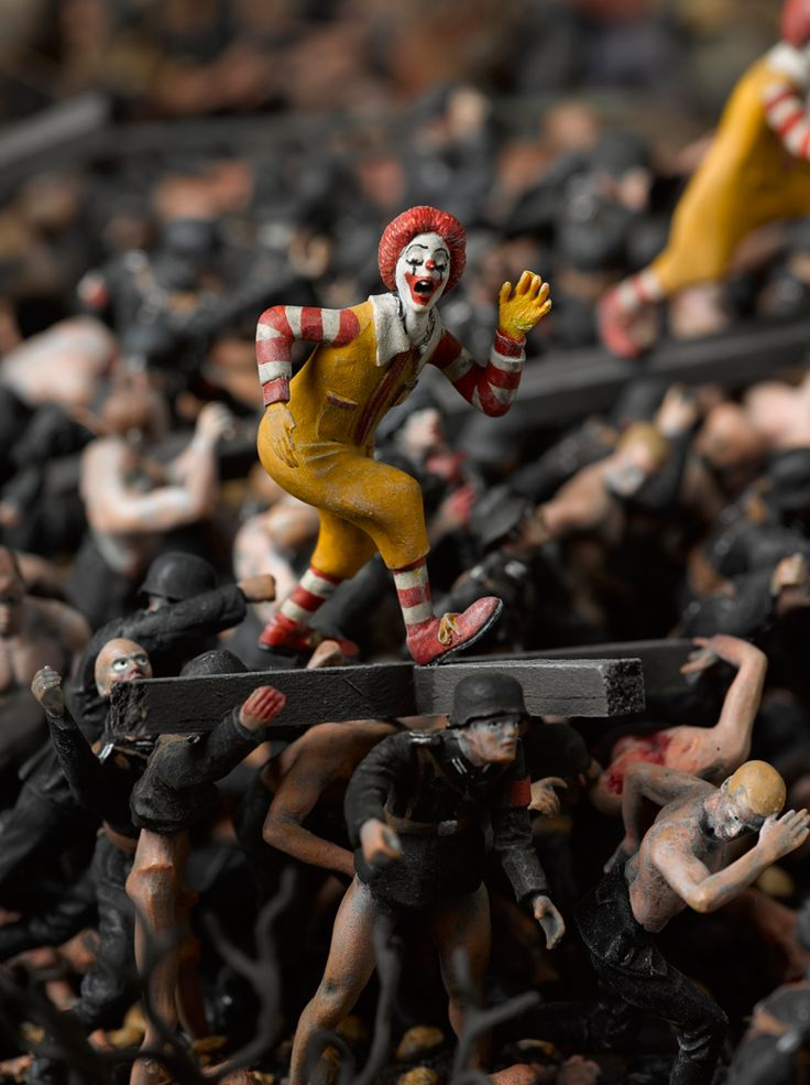 a detail, where ronald mcdonald walks atop a crucifix resting on nazi soldier's backs image courtesy of jake and dinos chapman