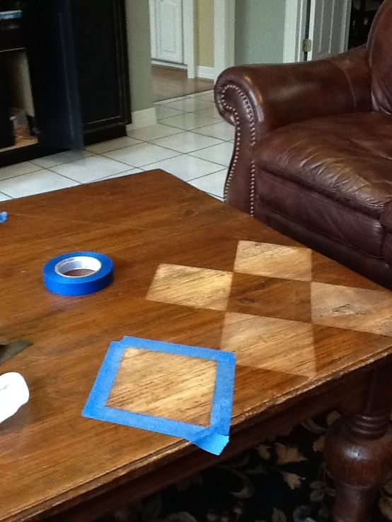 transform a wooden table top with tape and steel wool... Could do chevrons.