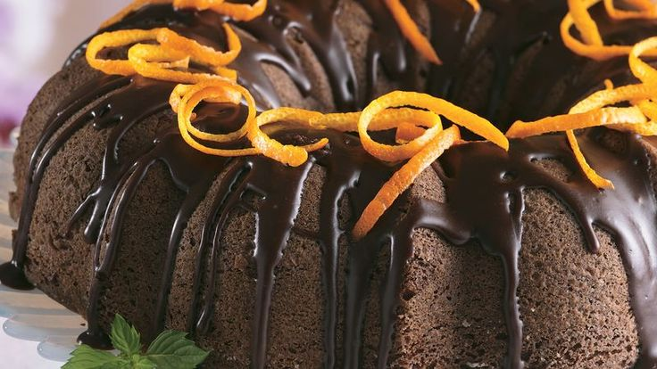 Tart orange juice and peel balance the rich chocolate cake and frosting in an attractive dessert.