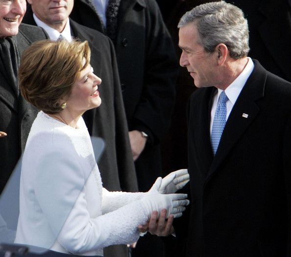 U.S. President George W. Bush is greeted by his wife Laura Bush as he enters the inaugural stage January 20, 2005 in Washington, D.C. U.S. President George W. Bush will be sworn in for a second term during the inaugural ceremony. (January 20, 2005