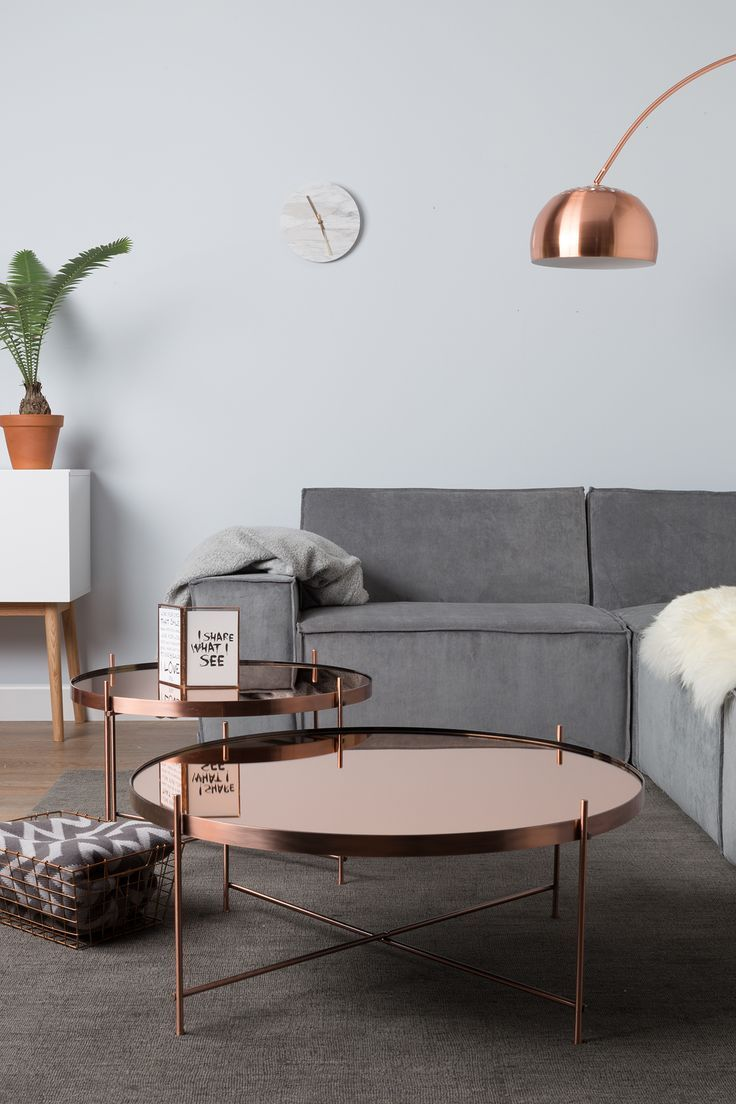 copper table, calm interiors and a cheeky plant can mean only one thing, a typical scandi inspired living space. gorgeous!